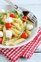 Pasta penne with cherry tomatoes and mozzarella cheese