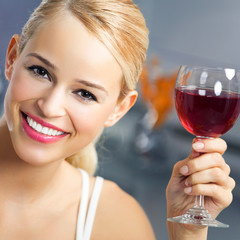 Woman with glass of redwine