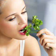 Woman eating coriander