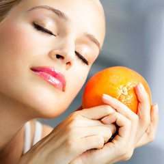 Young beautiful woman with orange
