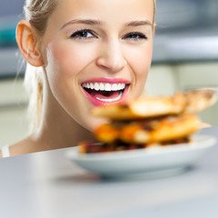 Young cheerful woman with pizza