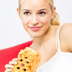 Cheerful woman with pie