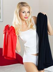 Young beautiful woman choosing dresses