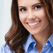 Cheerful young businesswoman at office