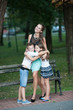 Mother with son adn daughter on a walk in park