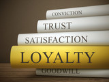 book title of loyality isolated on a wooden table poster