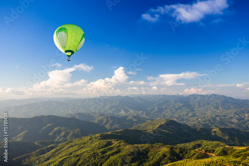 Hot air balloon over mountain