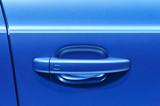 Fototapety Handle of sedan door. Fragment of blue metallic car body.