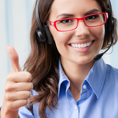 Support phone operator showing thumbs up