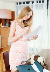 pregnancy woman looking paper document