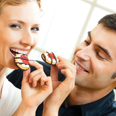 Couple eating cakes