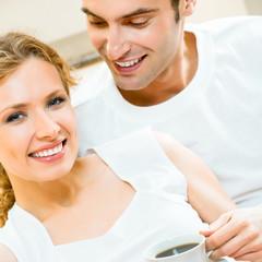 Cheerful couple with coffee