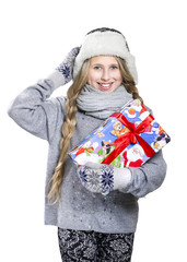 Teen girl with braids in  hat and mittens keeping the gift