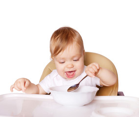 Baby eating with the left hand