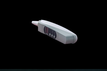 Ear - Thermometer to check for highfever in black background