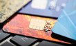 E-commerce concept. group of credit cards and laptop with shallo