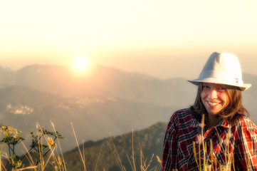 smiling beautiful girl on the top of the mountain