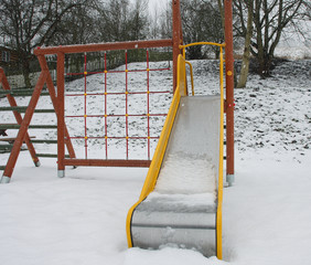 Colorful Playground in a park during snowstorm