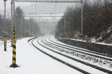 Czech train station at winter during  a snowstorm