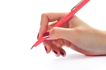 Woman's hand holding a pen isolated on white background