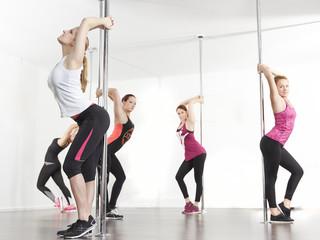 Sports group stretch for poledance