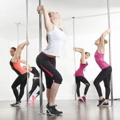 Girls group stretch for poledance