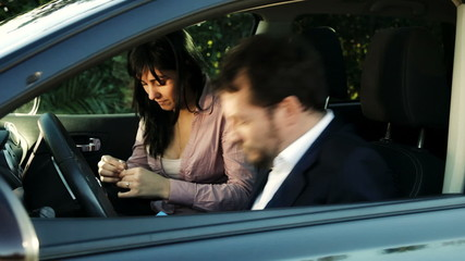 Business people in car sniffing drug cocaine