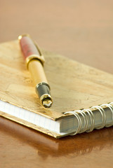 image of  notebook and pens on the table
