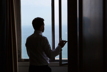 silhouette of young Italian groom before marriage