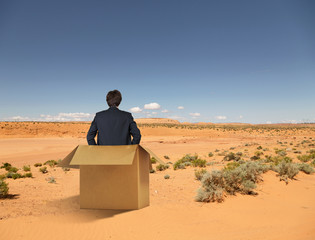 businessman sitting in box
