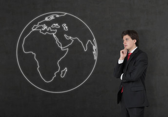 businessman looking to drawing earth