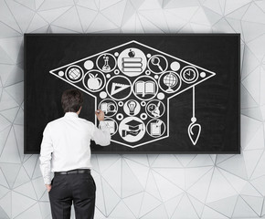 man drawing bachelor cap