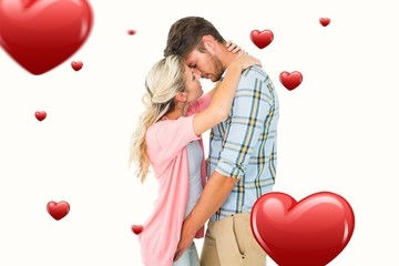 Composite image of attractive young couple about to kiss
