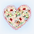 Greeting card with abstract heart with flowers