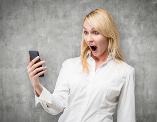 woman looking at cellphone