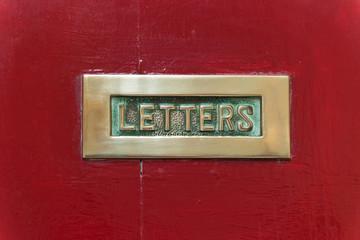 Letterbox on red door in ancient Mdina,  Malta