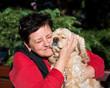 Happy senior woman with american spaniel
