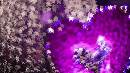 Defocused christmas lights on soft green colors tone