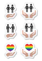 Rainbow, gay and lesbian symbols in heart with hands