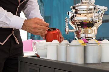 Waiter preparing tea