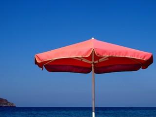 Sunshade, island and the sea