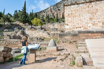 Visitor reading a description of an ancient ruin