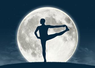 man practicing yoga at full moon