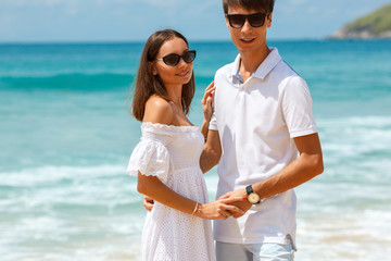 Lovely couple walking on a tropical beach