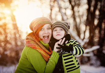Family in winter time having fun