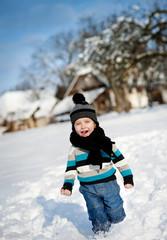 Little boy in the snow.