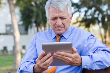 Closeup of a businessman working with a tablet