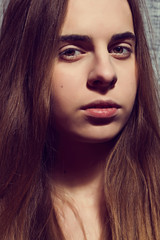 Close up portrait of young beautiful girl. Light-brown long hair