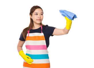 Housewife cleaning by rag with plastic gloves