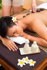 Indonesian man at hot stone wellness massage